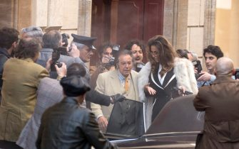 US actor Al Pacino (L) and Romanian actress Madalina Ghenea  (R) standin Via Condotti on the set during the shooting of the film 'House of Gucci' in Rome, Italy, 22 March 2021. The upcoming biopic crime movie directed by British filmmaker Ridley Scott is based on the 2001 book 'The House of Gucci: A Sensational Story of Murder, Madness, Glamor, and Greed' by Sara Gay Forden. ANSA/MASSIMO PERCOSSI