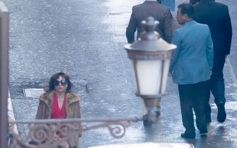Lady Gaga (C) in via Condotti on set during the shooting of the film 'House of Gucci' in Rome, Italy, 22 March 2021. The upcoming biopic crime movie directed by British filmmaker Ridley Scott is based on the 2001 book 'The House of Gucci: A Sensational Story of Murder, Madness, Glamor, and Greed' by Sara Gay Forden. ANSA/MASSIMO PERCOSSI