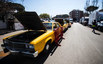 "American taxis on stage outside the set of the film ""House of Gucci"" by director Ridley Scott, set up in the ""Zita Fabiani"" fashion store in the Talenti district in Rome, Italy, 31 March 2021. ANSA/ANGELO CARCONI"