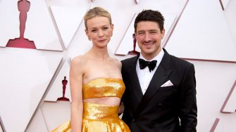 LOS ANGELES, CALIFORNIA â   APRIL 25: (EDITORIAL USE ONLY) In this handout photo provided by A.M.P.A.S., (L-R) Carey Mulligan and Marcus Mumford attend the 93rd Annual Academy Awards at Union Station on April 25, 2021 in Los Angeles, California. (Photo by Matt Petit/A.M.P.A.S. via Getty Images)