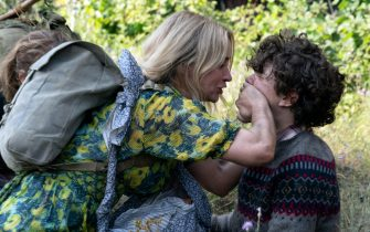 USA. Emily Blunt and Noah Jupe  in the (C)Warner Bros. new film : A Quiet Place Part II (2021) .  Plot: Following the events at home, the Abbott family now face the terrors of the outside world. Forced to venture into the unknown, they realize the creatures that hunt by sound are not the only threats lurking beyond the sand path.  Ref: LMK106-J7105-180521 Supplied by LMKMEDIA. Editorial Only. Landmark Media is not the copyright owner of these Film or TV stills but provides a service only for recognised Media outlets. pictures@lmkmedia.com