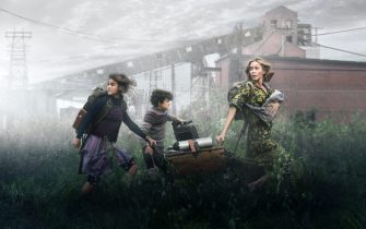 USA. Millicent Simmonds , Noah Jupe and Emily Blunt  in the (C)Warner Bros. new film : A Quiet Place Part II (2021) .  Plot: Following the events at home, the Abbott family now face the terrors of the outside world. Forced to venture into the unknown, they realize the creatures that hunt by sound are not the only threats lurking beyond the sand path.  Ref: LMK106-J7105-180521 Supplied by LMKMEDIA. Editorial Only. Landmark Media is not the copyright owner of these Film or TV stills but provides a service only for recognised Media outlets. pictures@lmkmedia.com