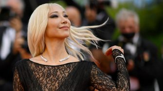 """South Korean model Soo-Joo Park poses as she arrives for the screening of the film """"Stillwater"""" at the 74th edition of the Cannes Film Festival in Cannes, southern France, on July 8, 2021. (Photo by CHRISTOPHE SIMON / AFP) (Photo by CHRISTOPHE SIMON/AFP via Getty Images)"""