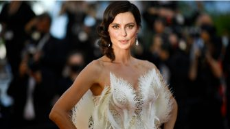 """Romanian model Catrinel Marlon poses as she arrives for the screening of the film """"Stillwater"""" at the 74th edition of the Cannes Film Festival in Cannes, southern France, on July 8, 2021. (Photo by CHRISTOPHE SIMON / AFP) (Photo by CHRISTOPHE SIMON/AFP via Getty Images)"""