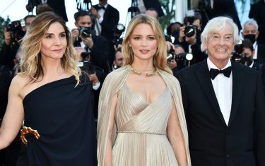 """CANNES, FRANCE - JULY 09: Clotilde Courau, Virgine Efira and director Paul Verhoeven attend the """"Benedetta"""" screening during the 74th annual Cannes Film Festival on July 09, 2021 in Cannes, France. (Photo by Dominique Charriau/WireImage)"""