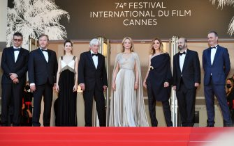"""CANNES, FRANCE - JULY 09: (L-R) Saïd Ben Saïd, Olivier Rabourdin, Daphne Patakia, Director Paul Verhoeven, Virginie Efira, Clotilde Courau, David Birke and Michel Merkt attend the """"Benedetta"""" screening during the 74th annual Cannes Film Festival on July 09, 2021 in Cannes, France. (Photo by Dominique Charriau/WireImage)"""