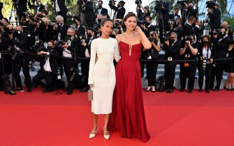 """French-Senegalese director and member of the Jury of the Official Selection Mati Diop (L)  and US actress and Jury member of the Official Selection Maggie GyllenhaalUS actress and Jury member of the Official Selection Maggie Gyllenhaal pose as they arrive for the screening of the film """"Benedetta"""" at the 74th edition of the Cannes Film Festival in Cannes, southern France, on July 9, 2021. (Photo by John MACDOUGALL / AFP) (Photo by JOHN MACDOUGALL/AFP via Getty Images)"""
