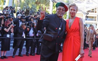 """US director and Jury President of the 74th Cannes Film Festival Spike Lee (L) and his wife Tonya Lewis Lee pose as they arrive for the screening of the film """"Benedetta"""" at the 74th edition of the Cannes Film Festival in Cannes, southern France, on July 9, 2021. (Photo by Valery HACHE / AFP) (Photo by VALERY HACHE/AFP via Getty Images)"""