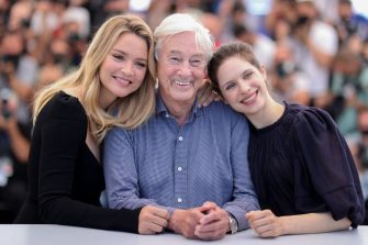 """(From L) Belgian actress Virginie Efira, Dutch film director Paul Verhoeven and Belgian-Greek actress Daphne Patakia pose during a photocall for the film """"Benedetta"""" at the 74th edition of the Cannes Film Festival in Cannes, southern France, on July 10, 2021. (Photo by Valery HACHE / AFP) (Photo by VALERY HACHE/AFP via Getty Images)"""