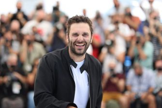 """French actor Pio Marmai laughs during a photocall for the film """"La Fracture"""" (The Divide) at the 74th edition of the Cannes Film Festival in Cannes, southern France, on July 10, 2021. (Photo by Valery HACHE / AFP) (Photo by VALERY HACHE/AFP via Getty Images)"""