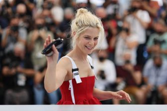 """French actress Marina Fois waves during a photocall for the film """"La Fracture"""" (The Divide) at the 74th edition of the Cannes Film Festival in Cannes, southern France, on July 10, 2021. (Photo by Valery HACHE / AFP) (Photo by VALERY HACHE/AFP via Getty Images)"""