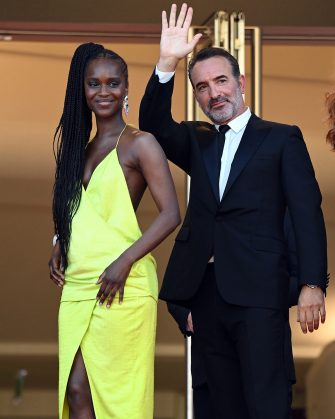 """CANNES, FRANCE - JULY 17:  Fatou N'Diaye and Jean Dujardin attend the final screening of """"OSS 117: From Africa With Love"""" and closing ceremony during the 74th annual Cannes Film Festival on July 17, 2021 in Cannes, France. (Photo by Daniele Venturelli/WireImage)"""