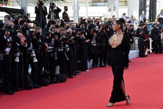 """US model Bella Hadid arrives for the screening of the film """"Tre Piani"""" (Three Floors) at the 74th edition of the Cannes Film Festival in Cannes, southern France, on July 11, 2021. (Photo by John MACDOUGALL / AFP) (Photo by JOHN MACDOUGALL/AFP via Getty Images)"""