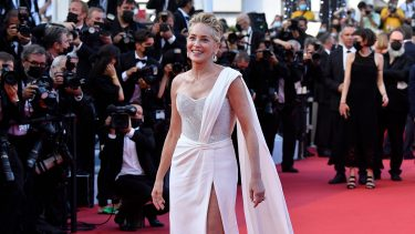 """US actress Sharon Stone arrives for the screening of the film """"OSS 117 : From Africa With Love (OSS 117 Alerte Rouge en Afrique Noire)"""" and the closing ceremony of the 74th edition of the Cannes Film Festival in Cannes, southern France, on July 21, 2021. (Photo by John MACDOUGALL / AFP) (Photo by JOHN MACDOUGALL/AFP via Getty Images)"""