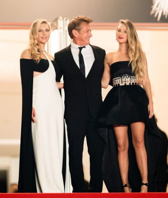 """CANNES, FRANCE - JULY 11: Sean Penn, Dylan Penn (r) Katheryn Winnick (L) attend the """"Flag Day"""" photocall during the 74th annual Cannes Film Festival on July 11, 2021 in Cannes, France. (Photo by Samir Hussein/WireImage)"""