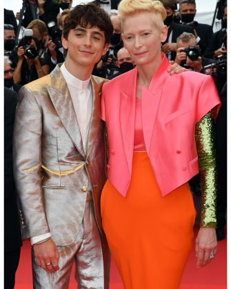 """CANNES, FRANCE - JULY 12: Tilda Swinton and Timothée Chalamet attend the """"The French Dispatch"""" screening during the 74th annual Cannes Film Festival on July 12, 2021 in Cannes, France. (Photo by Stephane Cardinale - Corbis/Corbis via Getty Images)"""