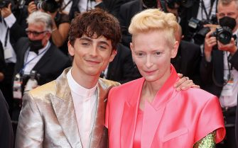 """CANNES, FRANCE - JULY 12: Timothée Chalamet and Tilda Swinton attend the """"The French Dispatch"""" screening during the 74th annual Cannes Film Festival on July 12, 2021 in Cannes, France. (Photo by Mike Marsland/WireImage)"""