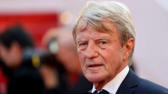 """Former French minister Bernard Kouchner arrives for the screening of the film """"A Felesegem Tortenete"""" (The Story Of My Wife) at the 74th edition of the Cannes Film Festival in Cannes, southern France, on July 14, 2021. (Photo by Valery HACHE / AFP) (Photo by VALERY HACHE/AFP via Getty Images)"""