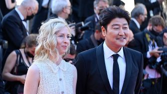 """Austrian director and member of the Jury of the Official Selection Jessica Hausner (L) and South Korean actor and member of the Jury of the Official Selection Song Kang-Ho arrive for the screening of the film """"A Felesegem Tortenete"""" (The Story Of My Wife) at the 74th edition of the Cannes Film Festival in Cannes, southern France, on July 14, 2021. (Photo by John MACDOUGALL / AFP) (Photo by JOHN MACDOUGALL/AFP via Getty Images)"""