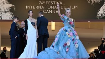 """US actress Sharon Stone waves as she arrives for the screening of the film """"A Felesegem Tortenete"""" (The Story Of My Wife) at the 74th edition of the Cannes Film Festival in Cannes, southern France, on July 14, 2021. (Photo by John MACDOUGALL / AFP) (Photo by JOHN MACDOUGALL/AFP via Getty Images)"""