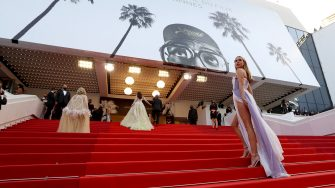 """British fashion designer Kimberley Garner arrives for the screening of the film """"France"""" at the 74th edition of the Cannes Film Festival in Cannes, southern France, on July 15, 2021. (Photo by Valery HACHE / AFP) (Photo by VALERY HACHE/AFP via Getty Images)"""
