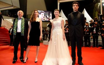 epa09341145 (L-R) Gregoire Hetzel, Laetitia Casta, Julia Boeme, and Louis Garrel arrive for the screening of 'Bac Nord' during the 74th annual Cannes Film Festival, in Cannes, France, 12 July 2021. The movie is presented Out of Official Competition at the festival which runs from 06 to 17 July.  EPA/Sebastien Nogier