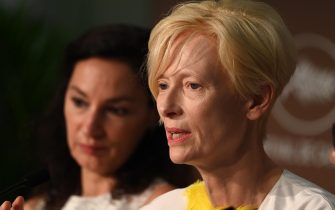 """epa09348219 Tilda Swinton attends the press conference for 'Memoria' during the 74th annual Cannes Film Festival, in Cannes, France, 16 July 2021. The festival runs from 06 to 17 July.  EPA/Kate Green / POOL *** Local Caption *** CANNES, FRANCE - JULY 16: Director Nabil Ayouch attends the """"Haut Et Fort (Casablanca Beats)"""" press conference during the 74th annual Cannes Film Festival on July 16, 2021 in Cannes, France. (Photo by Kate Green/Getty Images)"""