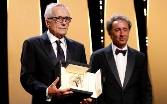 epa09350841 Italian director Marco Bellocchio (L) receives the Honorary Palme d'or during the Closing Awards Ceremony of the 74th annual Cannes Film Festival, in Cannes, France, 17 July 2021. The Golden Palm winning movie will be screened after the closing ceremony.  EPA/SEBASTIEN NOGIER