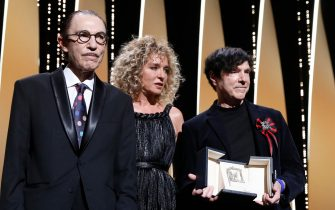 epa09350914 US music composer Ron Mael (L) and US music composer Russell Mael (R) pose on stage with Valeria Golino as they accept the 'Best Director' prize for the film 'Annette' on behalf on French director Leos Carax during the Closing Awards Ceremony of the 74th annual Cannes Film Festival, in Cannes, France, 17 July 2021. The Golden Palm winning movie will be screened after the closing ceremony.  EPA/SEBASTIEN NOGIER