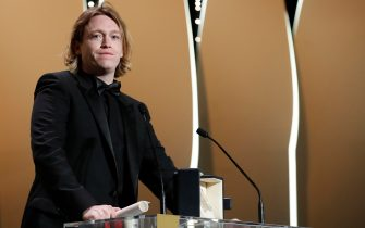 epa09350851 Caleb Landry Jones accepts the Best Actor Award for Nitram during the Closing Awards Ceremony of the 74th annual Cannes Film Festival, in Cannes, France, 17 July 2021. The Golden Palm winning movie will be screened after the closing ceremony.  EPA/SEBASTIEN NOGIER