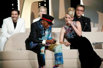 epaselect epa09350864 Spike Lee (front-L) speaks on stage next to other members of the jury during the Closing Awards Ceremony of the 74th annual Cannes Film Festival, in Cannes, France, 17 July 2021. The Golden Palm winning movie will be screened after the closing ceremony.  EPA/SEBASTIEN NOGIER