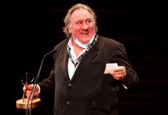 """French actor Gerard Depardieu receives a career achievement award at the El Gouna Film Festival in the Egyptian Red Sea resort of el Gouna on October 23, 2020. (Photo by Patrick BAZ / El Gouna Film Festival / AFP) / XGTY / RESTRICTED TO EDITORIAL USE - MANDATORY CREDIT """"AFP PHOTO / EL GOUNA FILM FESTIVAL / Patrick Baz - NO MARKETING NO ADVERTISING CAMPAIGNS - DISTRIBUTED AS A SERVICE TO CLIENTS - (Photo by PATRICK BAZ/El Gouna Film Festival/AFP via Getty Images)"""