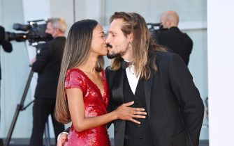 """VENICE, ITALY - SEPTEMBER 02: Zoe Saldana and Marco Perego attend the red carpet of the movie """"The Hand Of God"""" during the 78th Venice International Film Festival on September 02, 2021 in Venice, Italy. (Photo by Daniele Venturelli/WireImage)"""