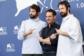 """VENICE, ITALY - SEPTEMBER 09: Director Damiano D'Innocenzo, Elio Germano and director Fabio Dâ  Innocenzo attend the photocall of """"America Latina"""" during the 78th Venice International Film Festival on September 09, 2021 in Venice, Italy. (Photo by Vittorio Zunino Celotto/Getty Images)"""