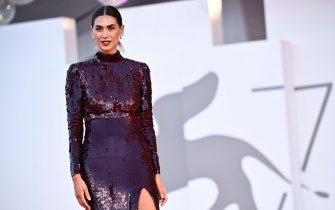 """Italian television presenter Melissa Satta arrives for the screening of the film """"America Latina"""" presented in competition on September 9, 2021 during the 78th Venice Film Festival at Venice Lido. (Photo by Marco BERTORELLO / AFP) (Photo by MARCO BERTORELLO/AFP via Getty Images)"""