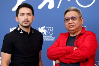 """VENICE, ITALY - SEPTEMBER 10: Dennis Trillo and irector Erik Matti attend the photocall of """"On The Job: The Missing 8"""" during the 78th Venice International Film Festival on September 10, 2021 in Venice, Italy. (Photo by John Phillips/Getty Images)"""