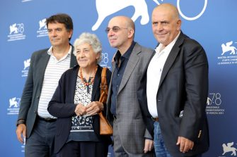 """VENICE, ITALY - SEPTEMBER 10: Giovanni Morricone, Maria Travia, Giuseppe Tornatore and Marco Morricone attend the photocall of """"Ennio (Ennio The Maestro)"""" during the 78th Venice International Film Festival on September 10, 2021 in Venice, Italy. (Photo by Vittorio Zunino Celotto/Getty Images)"""