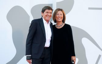 Italian singer Gianni Morandi and hi wife Anna (R) arrive for the premiere of  'Ennio (Ennio The Maestro)' during the 78th annual Venice International Film Festival, Venice, Italy, 10 September 2021. The movie is presented out of competition at the festival running from 01 to 11 September.  ANSA/ETTORE FERRARI
