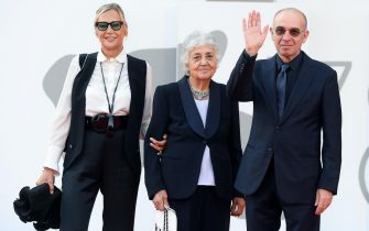 Maria Travia Morricone (C) with Italian filmmaker Giuseppe Tornatore and his wife Roberta Pacetti (L) arrive for the premiere of  'Ennio (Ennio The Maestro)' during the 78th annual Venice International Film Festival, Venice, Italy, 10 September 2021. The movie is presented out of competition at the festival running from 01 to 11 September.  ANSA/ETTORE FERRARI