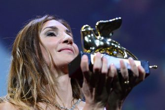 """French director Audrey Diwan acknowledges receiving the Golden Lion for Best Film for """"L'Evenement"""" (Happening) during the closing ceremony of the 78th Venice Film Festival on September 11, 2021 at Venice Lido. (Photo by Filippo MONTEFORTE / AFP) (Photo by FILIPPO MONTEFORTE/AFP via Getty Images)"""