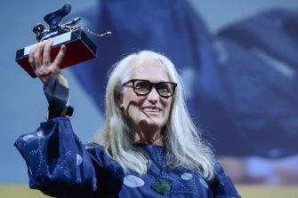 """New Zealand director Jane Campion acknowledges receiving the Silver Lion for Best Director for """"The Power of the Dog"""" during the closing ceremony of the 78th Venice Film Festival on September 11, 2021 at Venice Lido. (Photo by Filippo MONTEFORTE / AFP) (Photo by FILIPPO MONTEFORTE/AFP via Getty Images)"""