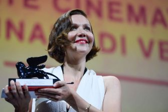 """US director and actress Maggie Gyllenhaal acknowledges receiving the Award for Best Screenplay for """"The Lost Daughter"""" during the closing ceremony of the 78th Venice Film Festival on September 11, 2021 at Venice Lido. (Photo by Filippo MONTEFORTE / AFP) (Photo by FILIPPO MONTEFORTE/AFP via Getty Images)"""