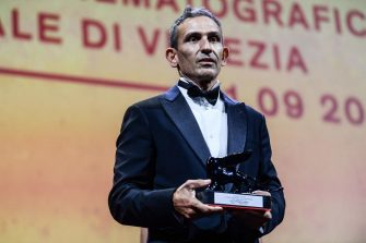"""Italian director Michelangelo Frammartino acknowledges receiving the Special Jury Prize for """"Il Buco"""" (The Hole) during the closing ceremony of the 78th Venice Film Festival on September 11, 2021 at Venice Lido. (Photo by Filippo MONTEFORTE / AFP) (Photo by FILIPPO MONTEFORTE/AFP via Getty Images)"""
