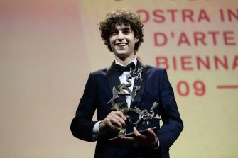 """Italian actor Filippo Scotti acknowledges receiving the """"Marcello Mastroianni"""" Award for Best New Young Actor for """"E Stato la mano di Dio"""" (The Hand of God) during the closing ceremony of the 78th Venice Film Festival on September 11, 2021 at Venice Lido. (Photo by Filippo MONTEFORTE / AFP) (Photo by FILIPPO MONTEFORTE/AFP via Getty Images)"""
