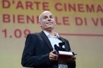 """French director Eric Gravel acknowledges receiving the Orizzonti Award for Best Director for """"A Plein Temps"""" (Full Time) during the closing ceremony of the 78th Venice Film Festival on September 11, 2021 at Venice Lido. (Photo by Filippo MONTEFORTE / AFP) (Photo by FILIPPO MONTEFORTE/AFP via Getty Images)"""