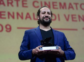 """Bolivian director Kiro Russo acknowledges receiving the Special Orizzonti Jury Prize for """"El Gran movimento"""" during the closing ceremony of the 78th Venice Film Festival on September 11, 2021 at Venice Lido. (Photo by Filippo MONTEFORTE / AFP) (Photo by FILIPPO MONTEFORTE/AFP via Getty Images)"""
