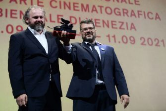 """Screenwriters Ivan Ostrochovsky (L) and Peter Kerekes acknowledge receiving the Orizzonti Award for Best Screenplay for """"Cenzorka (107 Mothers)"""" during the closing ceremony of the 78th Venice Film Festival on September 11, 2021 at Venice Lido. (Photo by Filippo MONTEFORTE / AFP) (Photo by FILIPPO MONTEFORTE/AFP via Getty Images)"""