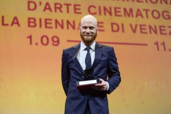 """Producer Lucas Engel acknowledges receiving, on behalf of directors Cristobal Leon and Joaquin Cocina, the Orizzonti Award for Best Short Film for """"Los Huesos"""" during the closing ceremony of the 78th Venice Film Festival on September 11, 2021 at Venice Lido. (Photo by Filippo MONTEFORTE / AFP) (Photo by FILIPPO MONTEFORTE/AFP via Getty Images)"""