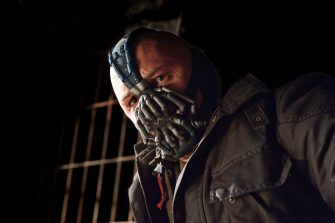 TOM HARDY as Bane in Warner Bros. Picturesâ   and Legendary Picturesâ   action thriller â  THE DARK KNIGHT RISES,â   a Warner Bros. Pictures release. TM & © DC Comics.