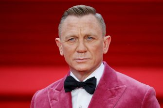 """English actor Daniel Craig poses on the red carpet after arriving to attend the World Premiere of the James Bond 007 film """"No Time to Die"""" at the Royal Albert Hall in west London on September 28, 2021. - Celebrities and royals walk the red carpet in central London on Tuesday for the star-studded but much-delayed world premiere of the latest James Bond film, """"No Time To Die"""". (Photo by Tolga Akmen / AFP) (Photo by TOLGA AKMEN/AFP via Getty Images)"""